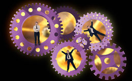Part of the team effort. A look into the enterprise - teamwork concept with businessman inside cogwheels Royalty Free Stock Photo