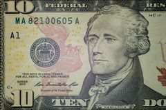 Macro. Part of the ten-dollar bill of the United States with a portrait of Hamilton and a serial number. Close-up. High detail. Part of the ten-dollar bill of royalty free stock photos