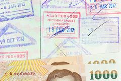 Part of Thai banknote on opening passport Stock Photography