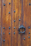 Part of thick very old wooden door of church or medieval buildin Stock Image