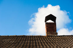 A part of tiling roof with chimney heaven background Stock Image