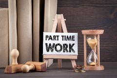 Part time work. Sandglass, hourglass or egg timer on wooden table Stock Photography