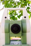 Part of total station instruments telescope focusing ring. Survey Instrument geodetic device, total station set in the field Royalty Free Stock Images