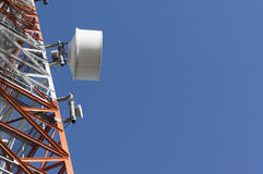 Part of a tower with antennas. Against blue sky and clouds under sunlight Royalty Free Stock Photography