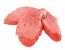 Part trois de viande rouge d'isolement sur le blanc images stock