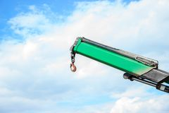 Part of the truck crane. Crane hook against the sky.  Stock Images