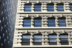 Part of two facades of high rise buildings in new york city with Royalty Free Stock Photography