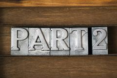 Part 2. Part two phrase made from metallic letterpress type on wooden tray Royalty Free Stock Image