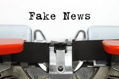 Part of typing machine with typed Fake News words. Close-up royalty free stock photo