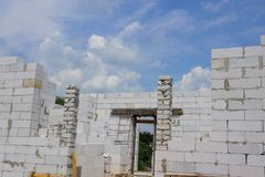 Part of an unfinished house on a white brick building site. Against the sky stock image