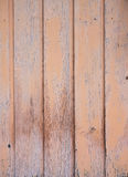 Part of vertical planks of shed wall with peeling pink paint Stock Photography