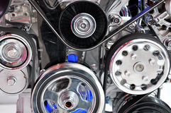 Part view of engine. Car engine part detail, composed by running wheels and belt, shown as mechanical, busy, powerful and complicated concept Stock Photo