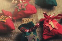 part view on traditional advent calendar with small fabric bags for individual filling atatched to a rough fabric Royalty Free Stock Photography