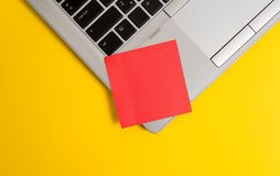 Part view trendy metallic laptop blank sticky note colored background. Personal computer small sheet paper empty text stock images