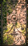 Part of rusty gate. Vignette effect. Part of vintage cast iron gate. Vignette effect Royalty Free Stock Images