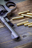 Part of an vintage nagant revolver with cartridges Royalty Free Stock Photography
