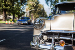 Part of a vintage old beige car with headlamp Royalty Free Stock Photo