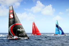 A part of the Volvo Ocean Race fleet sailing. Team Scallywag, Team Mapfre and Team Vestas in battle sailing in open waters Royalty Free Stock Photos