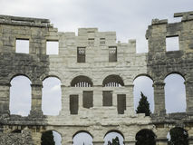 Part of the wall. Amphitheater 1st century AD in Pula. Archs and columns stock image