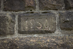 A part of a wall built in 1950. A wall built in the year 1950, dated part of a wall royalty free stock photo