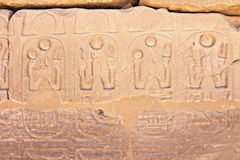 Part of wall with hieroglyphs in Karnak, Egypt. Part of a wall with hieroglyphs and shadow as background Royalty Free Stock Image