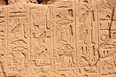 Part of a wall with hieroglyphs in Karnak, Egypt. Part of a wall with hieroglyphs and shadow as background Stock Photo