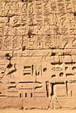 Part of a wall with hieroglyphs in Karnak, Egypt. Part of a wall with hieroglyphs and shadow as background Royalty Free Stock Photography