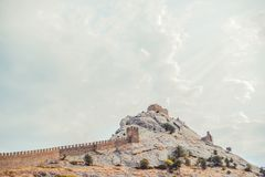 Genoese fortress in Sudak, the Crimea Peninsula, Black sea. Consular castle and the fortification wall of the upper tier. Royalty Free Stock Images