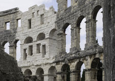 Part of the wall under angle. Pula Arena - Amphitheater 1st century AD in Pula. Stock Image
