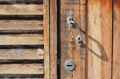 Part of the wall and wooden door Royalty Free Stock Photos