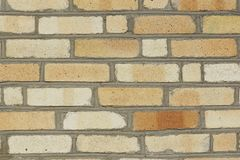 Part of the wall of a yellow brick. Stock Photography