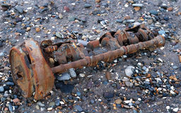 Part of wartime engine on beach in east Yorkshire, UK. Royalty Free Stock Images