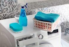 Laundry powder on washing machine. Part of washing machine and laundry powder for washing day Royalty Free Stock Photography
