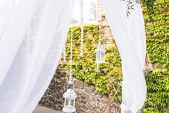 Part of wedding arch decorated with White lantern with a candle and a beautiful bunch of eucalyptus. Details Royalty Free Stock Photography