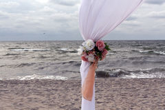 Part of wedding gate on the sea shore. Holidays and celebrations on Baltic sea royalty free stock photos