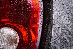 Part of a wet car. The rear part of the wet brown car close-up Royalty Free Stock Photo