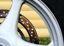 Part of a wheel. Part of a rim and a tire of a motorcycle wheel royalty free stock photos