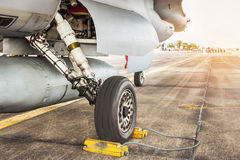 Part of wheel and brake system of f16 falcon fighter jet military aircraft. Detail part of wheel and brake system of f16 falcon fighter jet military aircraft on Stock Image