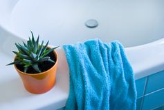 Part of white bath with azure blue towel Stock Images