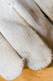 Part of white cotton gloves. close-up backgrounds Stock Image