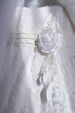 Part of a white dress for wedding decorated Stock Images
