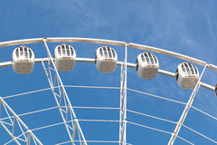 Part of white ferris wheel against blue sky Royalty Free Stock Image