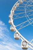 Part of white ferris wheel against blue sky Stock Photos