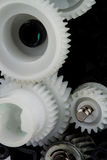 Part of white plastic gears Stock Images