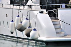 Part of white yacht in big size. Hanging floater in white and blue color of a white yacht stop in harbor, shown as luxury yacht hardware and facilities, maritime Stock Photography