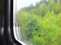 Part of a window of a moving electric train Stock Photo