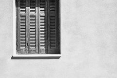 Part window with a shutters on house facade Royalty Free Stock Photo