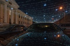 Part of a winter street lit by garlands Stock Images