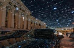 Part of a winter street lit by garlands Stock Photos