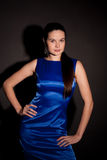 Part of woman in blue dress Royalty Free Stock Images